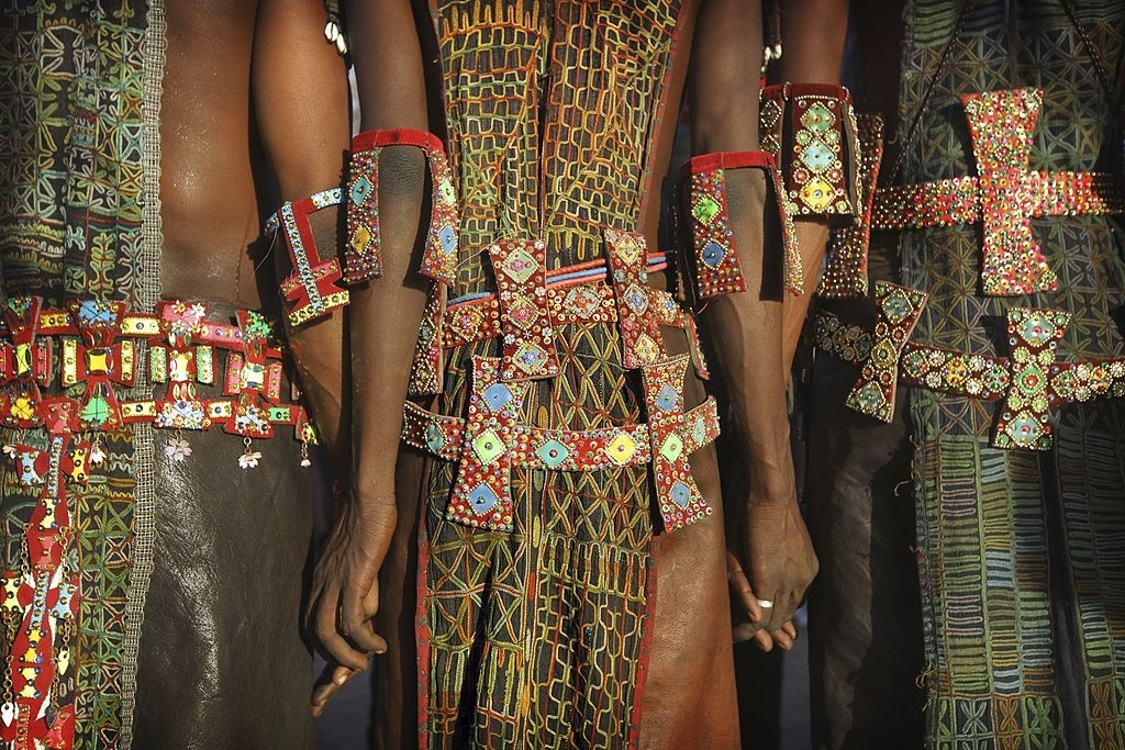 In a remote part of the Sahara desert near lake Chad, the nomadic Wodaabe tribe (a subgroup of the Fulani ethnic group) take part in an annual courtship ritual competition called Gerewol ( Guérewol ) during which Young men dressed in elaborate ornamentation and made up in traditional face painting gather in lines to dance and sing, vying for the attentions of marriageable young women.
